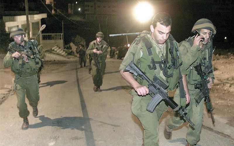 חיילים בחברון. צילום רויטרס (למצולמים אין קשר לידיעה)